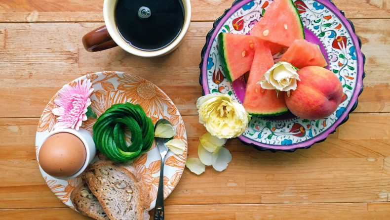 Breakfast of avocado toast and watermelon beautifully presented