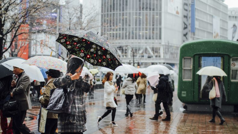 Tokyo, Japan - March 25, 2010: Photo of people near the Shibuya cross in Tokyo in a rainy day.