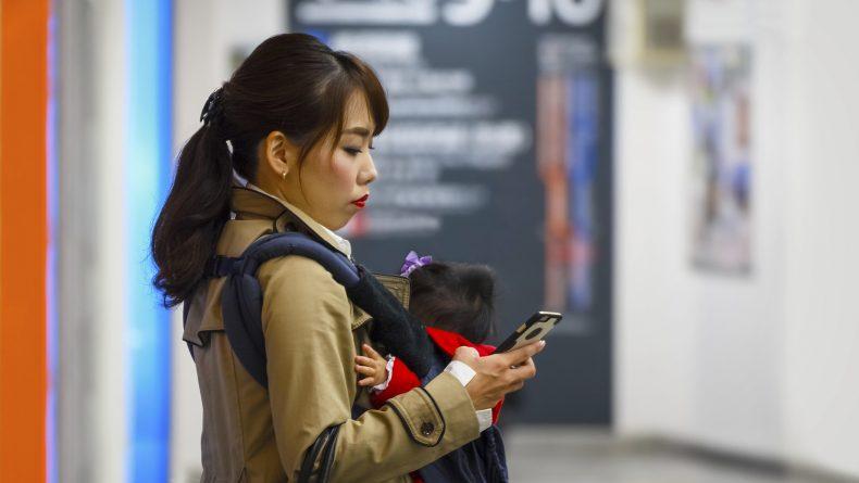 Yokohama, Japan - November 24 2015: Unidentified Japanese mother with her baby